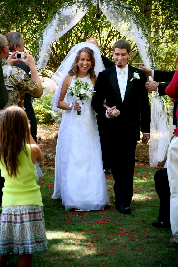 Recessional  - Dried red milo berries on grass