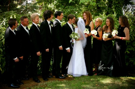 wedding party - bridesmaids and groomsmen in black