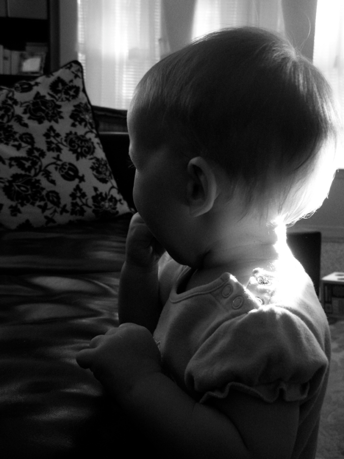 Black and white photo of baby in morning light