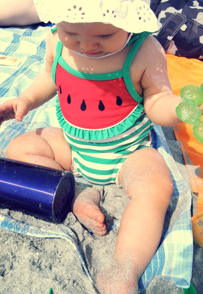 Aveline wearing striped watermelon bathing suit
