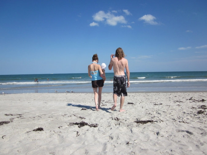 Gina and Josiah walking toward ocean at Cocoa Beach in FLorida