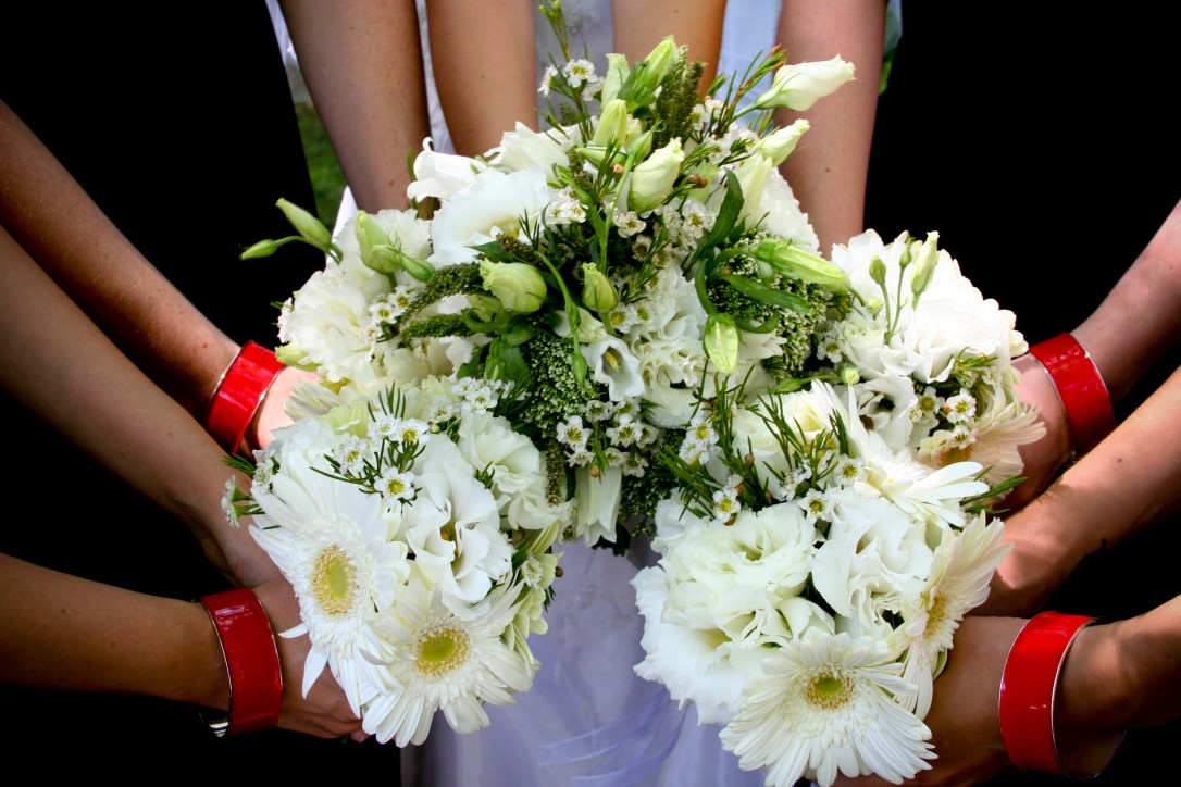 bridal and bridesmaids bouquet with red bracelets