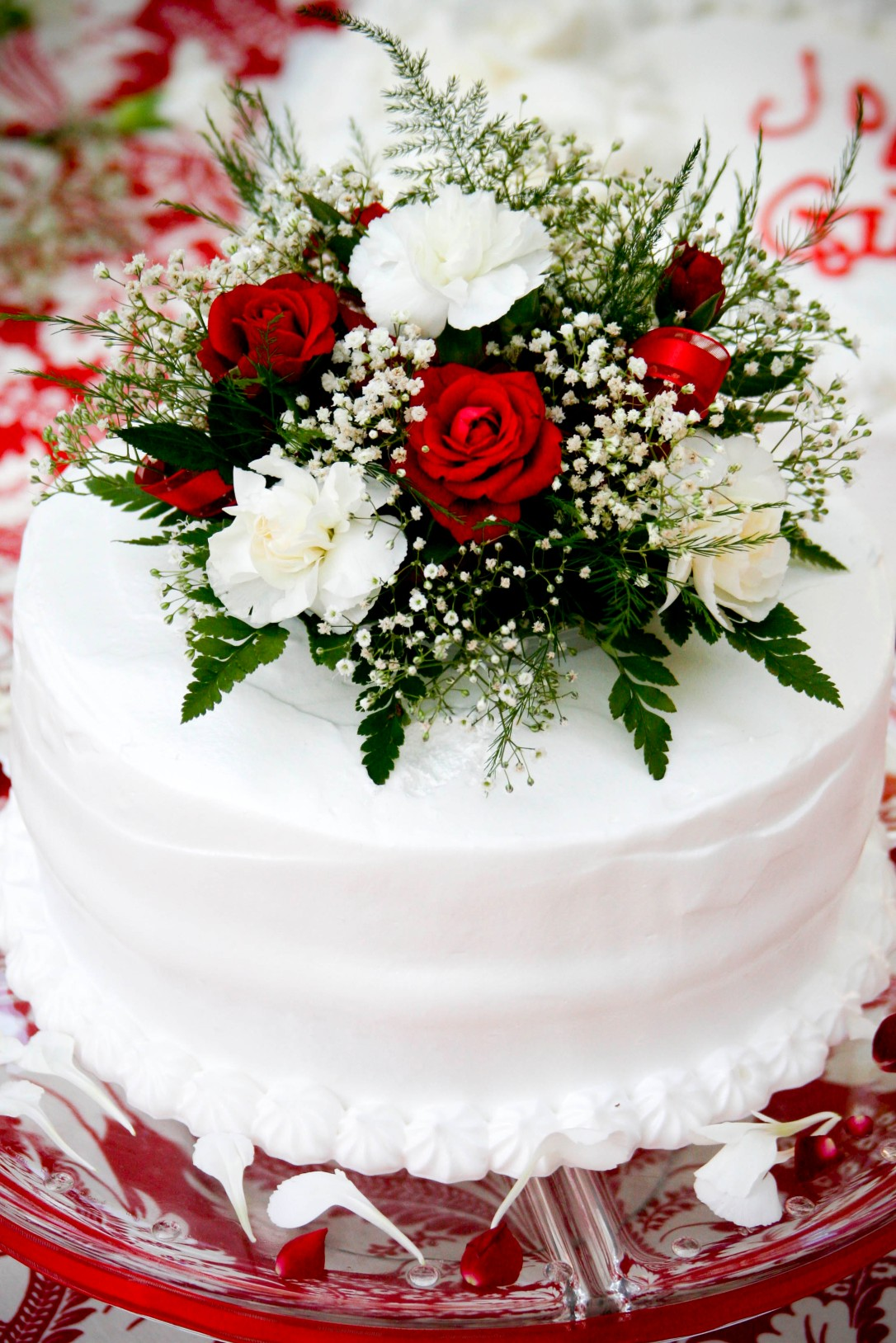 Wedding cake on red damask tablecloth