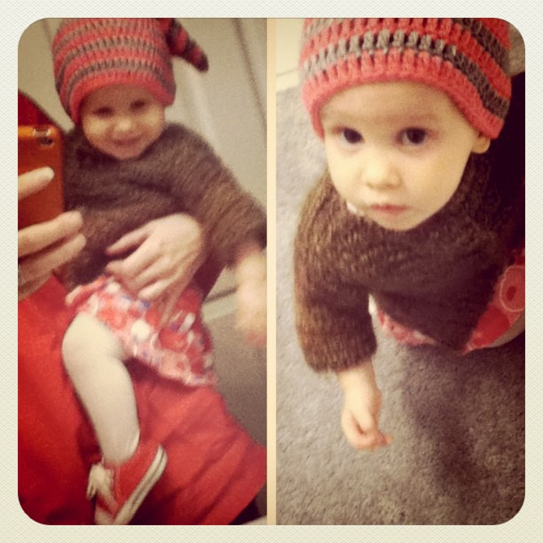 Baby in handmade sweater and handmade pixie hat