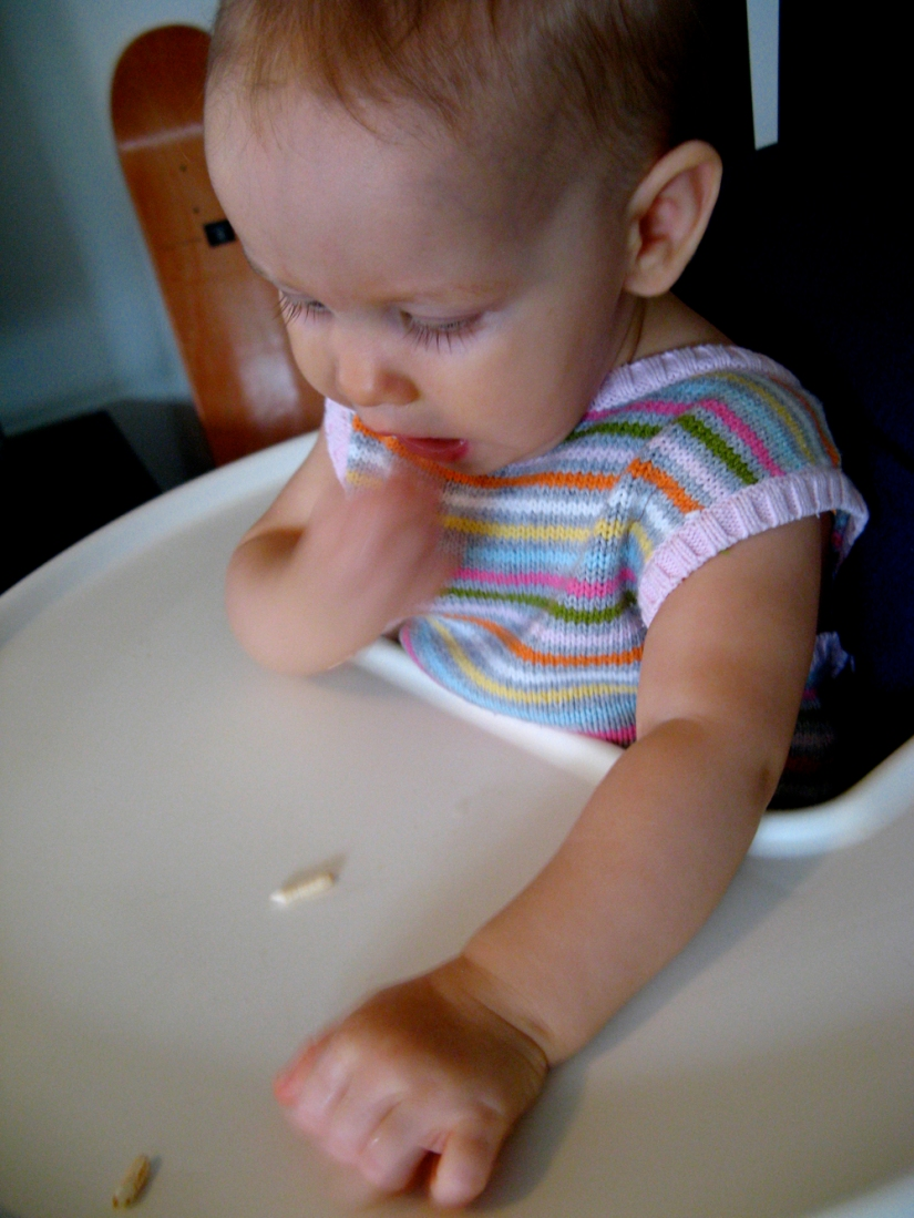 Aveline feeding herself