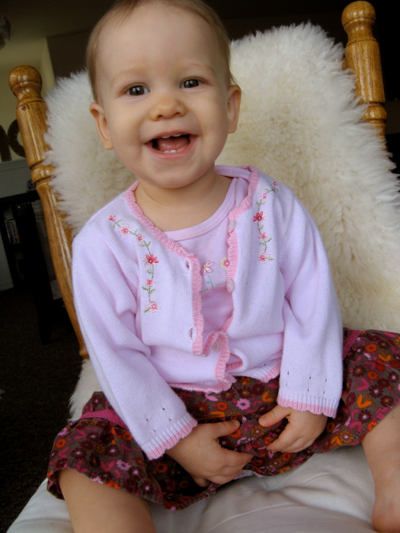 Aveline in sweater set and skirt, on chair