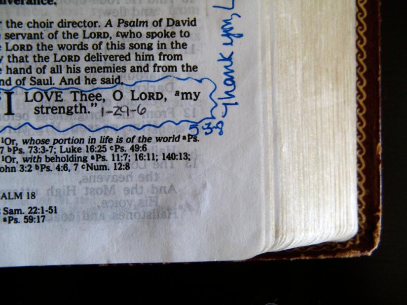 corner of bible on black
