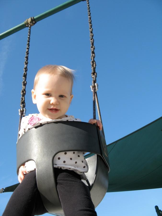 Aveline swinging - blue skies