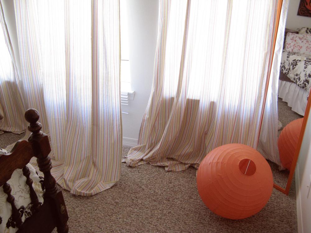 Striped Curtains in Wind, Orange Paper Lantern, Orange Mirror