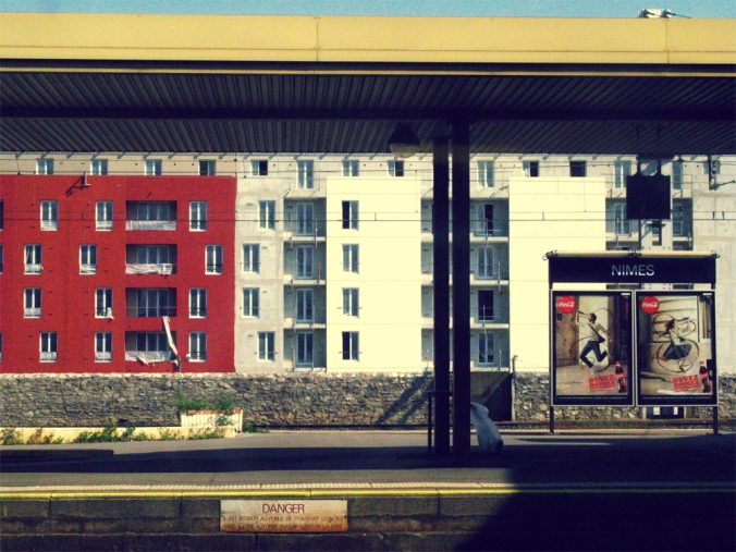 Europe train platform -- colored apartments