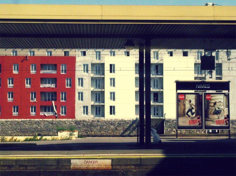 Europe train platform -- colored apartments