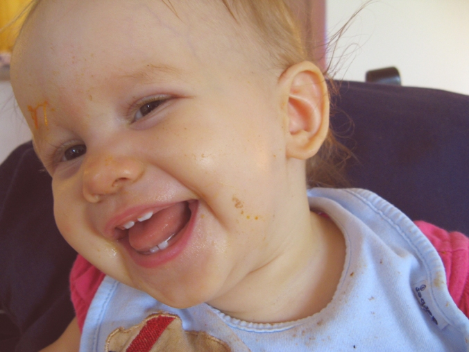 Messy baby eating and laughing