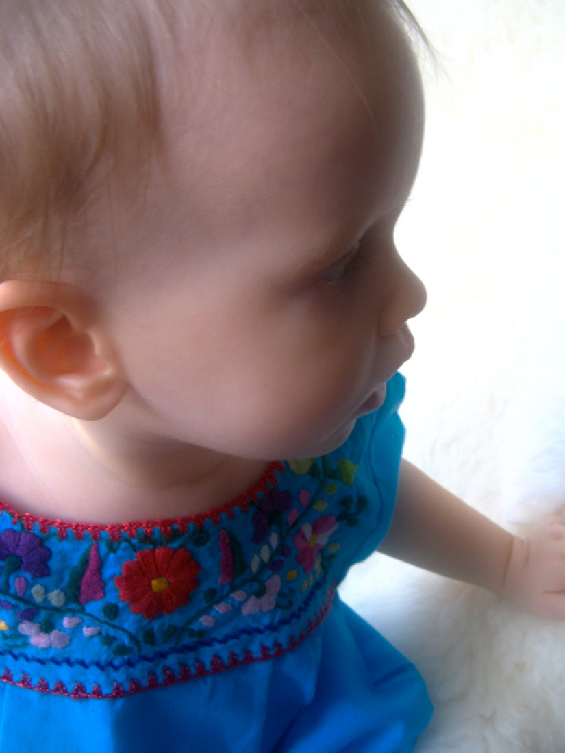 Baby Aveline wearing traditional Oaxaca Mexican Embroidered Shirt Dress
