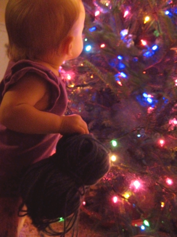 Aveline holding yarn looking at tree