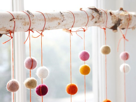 Felt balls on string hung from birch branch - Felt Ball Cascade Kit via the ACME Party Box Company