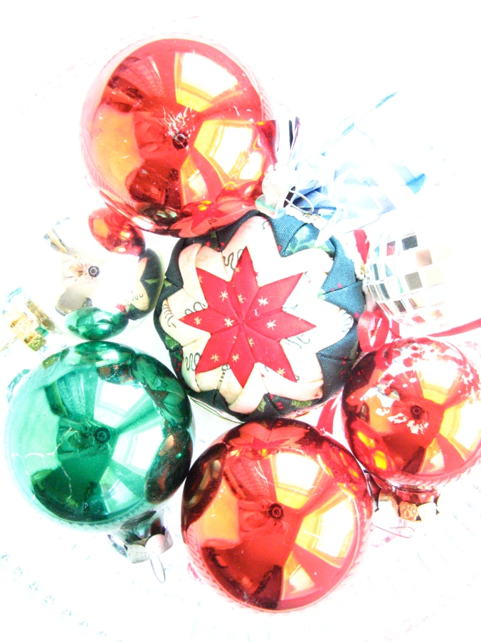 Over exposed photo of christmas ornaments on white background