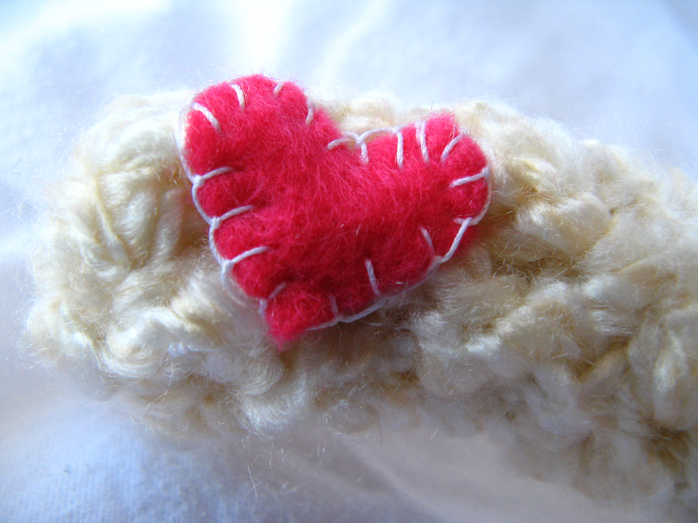 Kawaii Plush Creature - Blanket Stitch Pink Felt Heart on Crocheted Palm