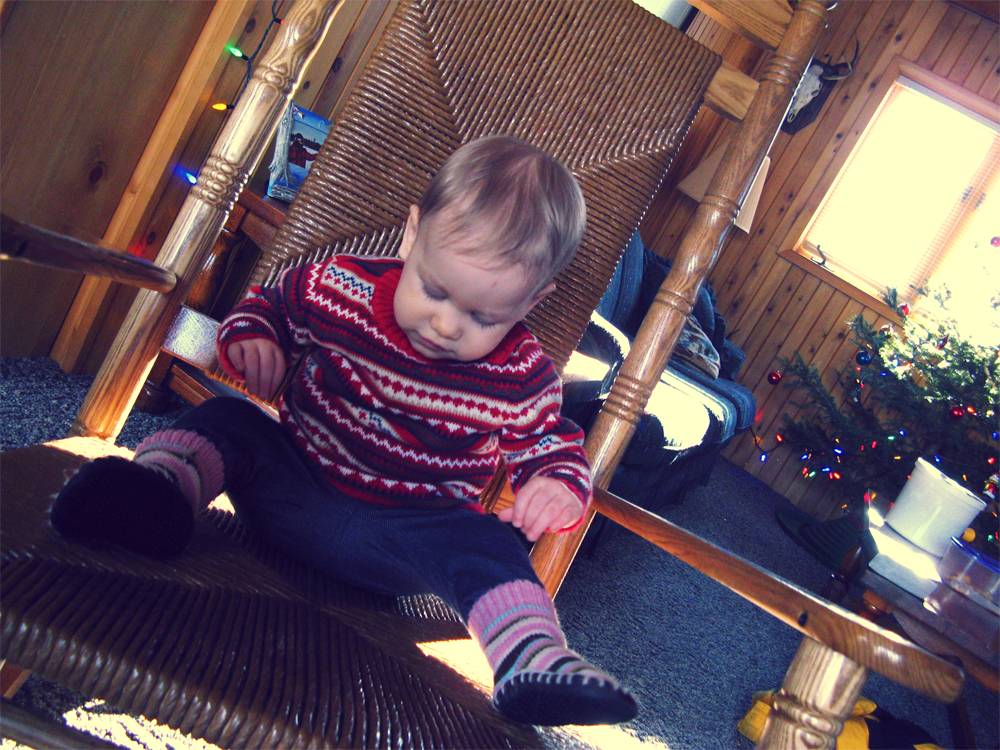 Aveline in huge wicker rocking chair at cabin in Upper Peninsula of Michigan