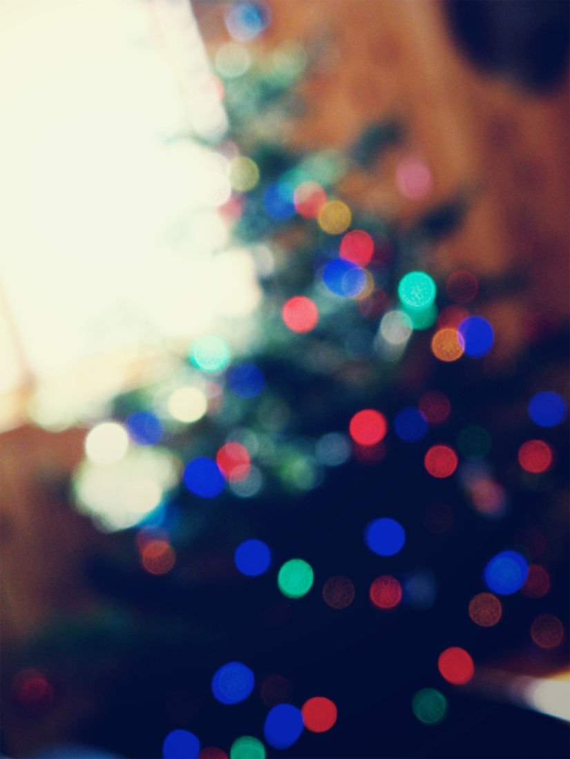 Bokeh Christmas tree near window