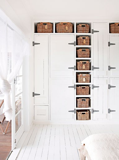 Australian House and Garden - White on white interior - Oversize Hinges on Closet - Wicker Baskets