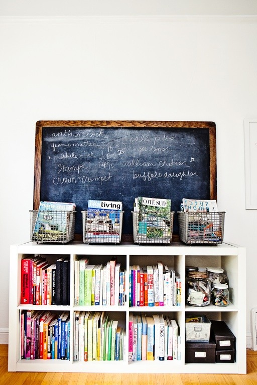 Books organized by color, wire baskets, and chalkboard via Rue Magazine Work Spaces Gallery