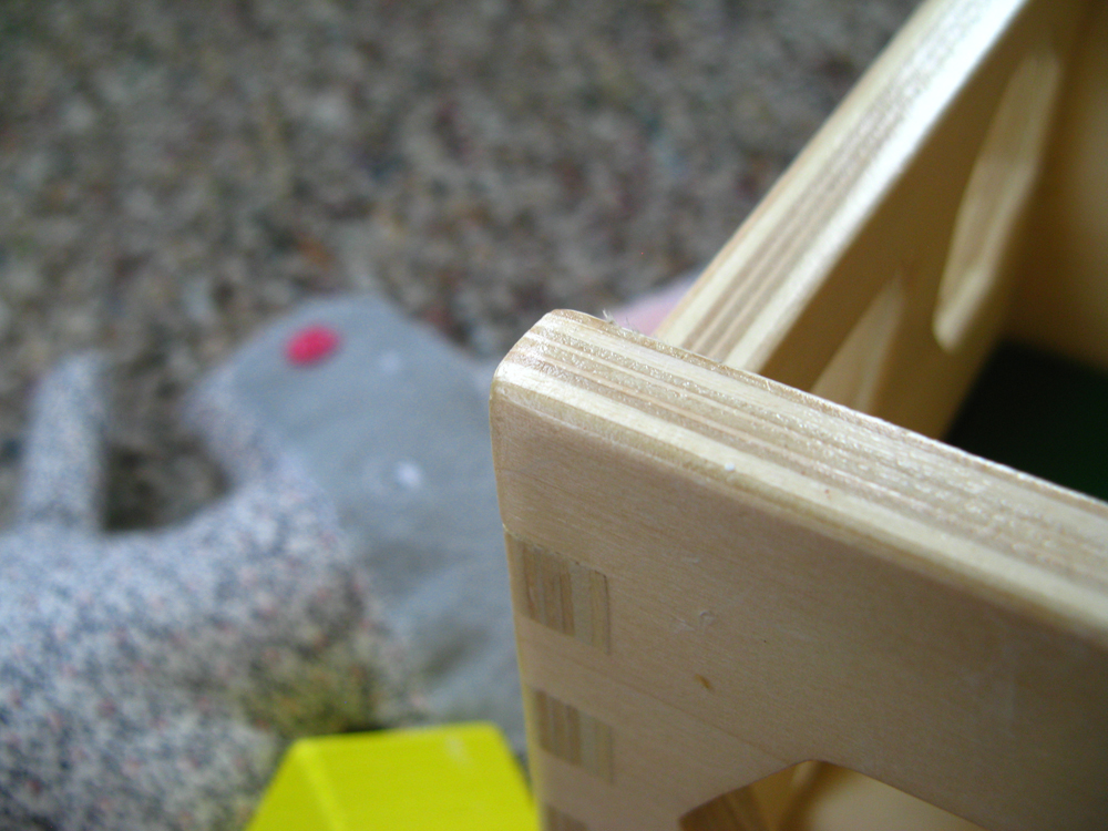 Wooden shape sorter and stuffed plush animal