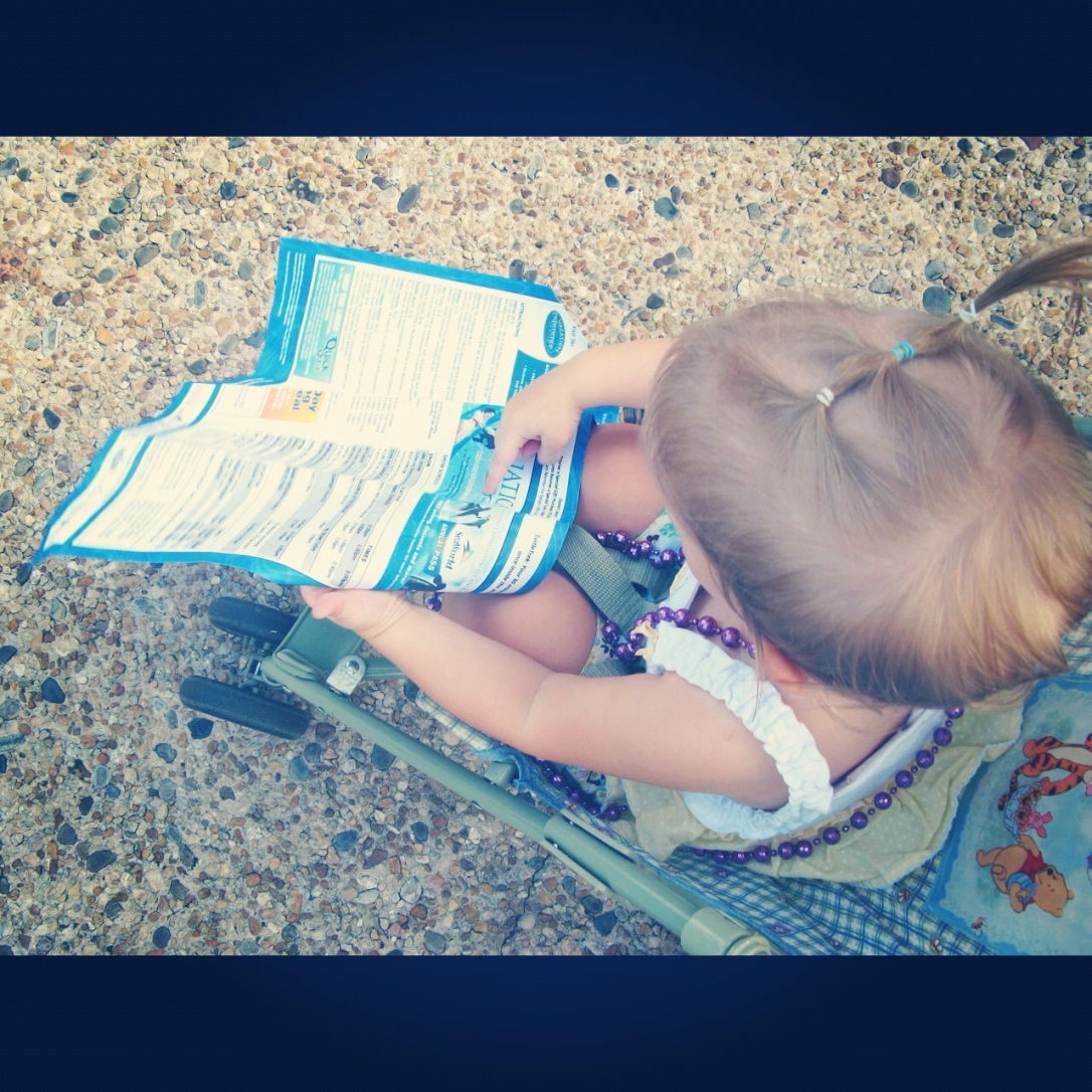 Aveline reading the Sea World map upsidedown