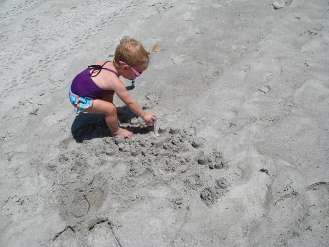 Aveline destroying sand castle with pink teacup