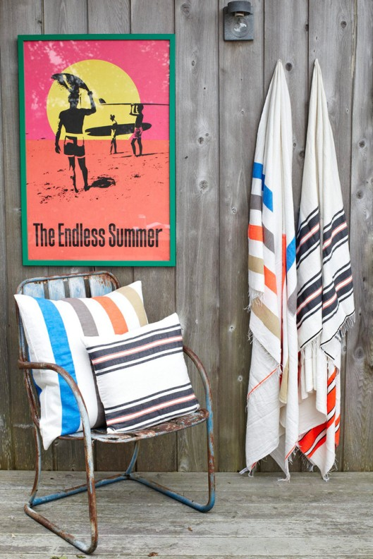 Endless Summer surf movie poster and and Zoza Ethopian striped blanket via Lemlem