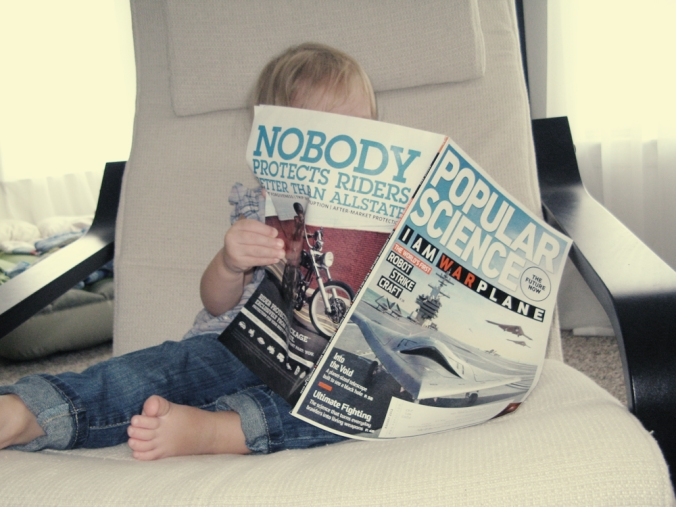 Toddler reading Popular Science - photo via Oaxacaborn dot com