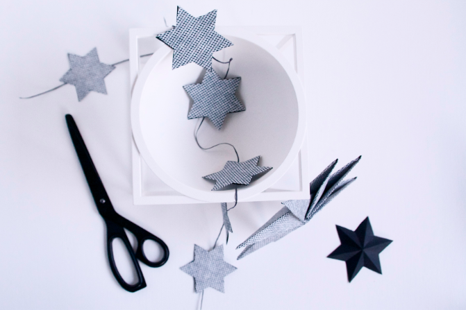 Make a paper star garland via the Cherry Blossom Blog