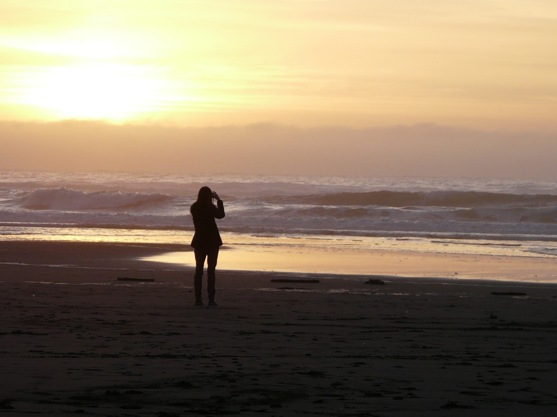 Gina taking photos at Bodega Bay at sunset