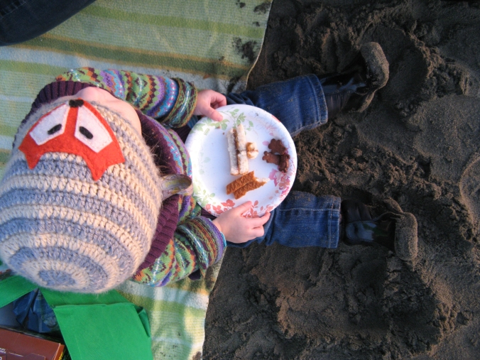 January 2013 - Aveline eats a picnic lunch on the beach in winter