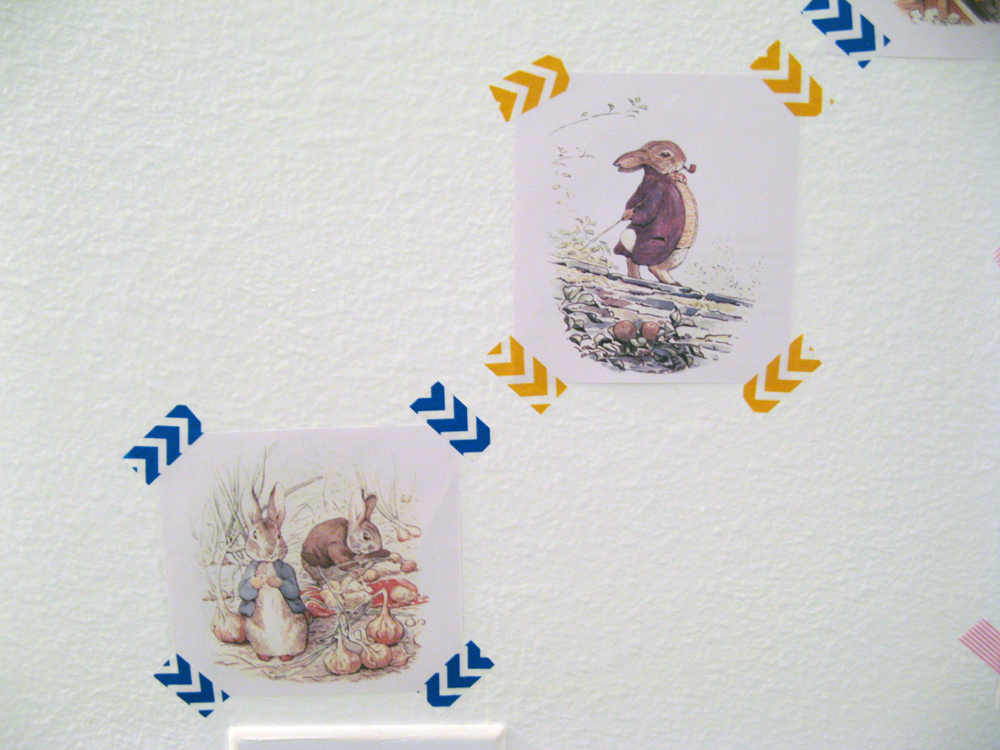 Aveline's room tour via Oaxacaborn - Pages from a Peter Rabbit Beatrix Potter book washi taped to wall