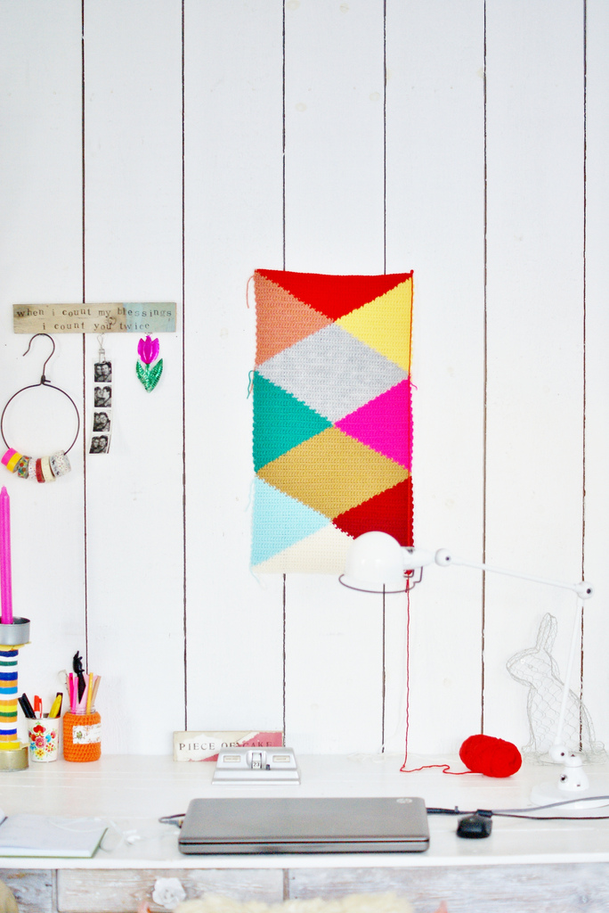 Diamond Cushion in Progress Hanging on White Wall via wood & wool stool