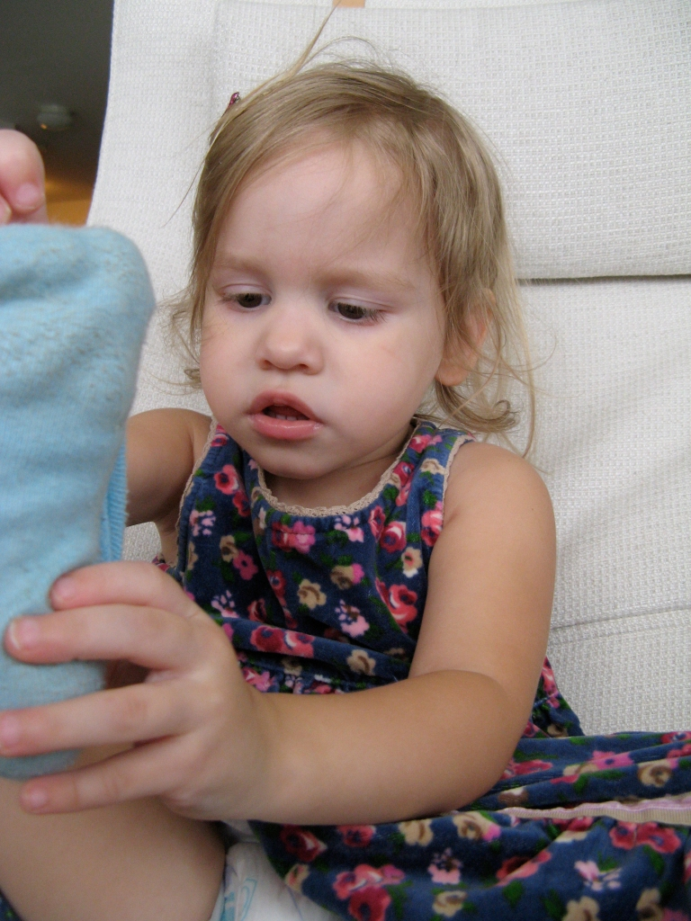 April 2013 - Aveline taking off her sock