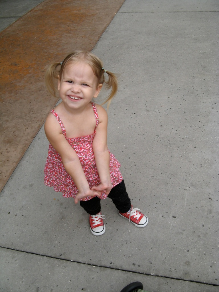 Toddler in pigtails and sneakers via Oaxacaborn