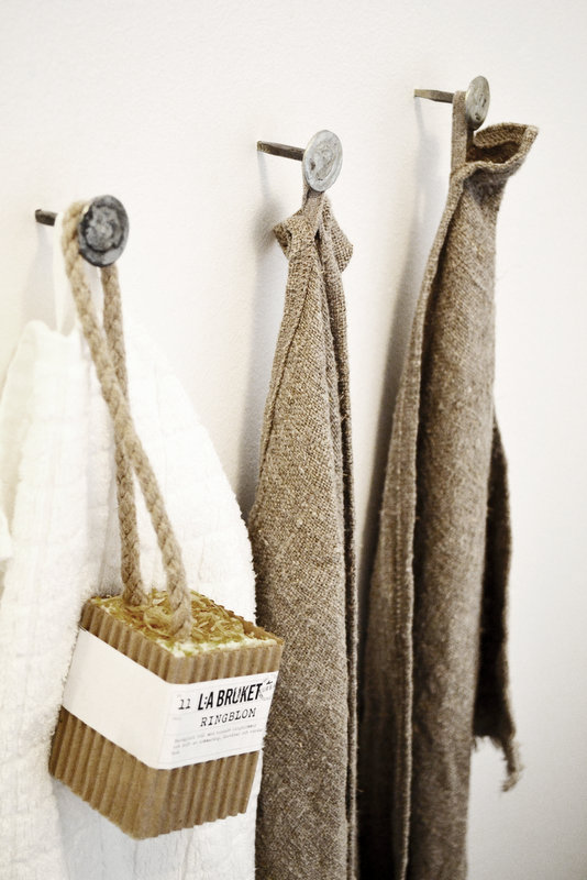 Linen and Burlap Towels Hanging on Nails with Soap from the Portfolio of Johanna Pilfalk