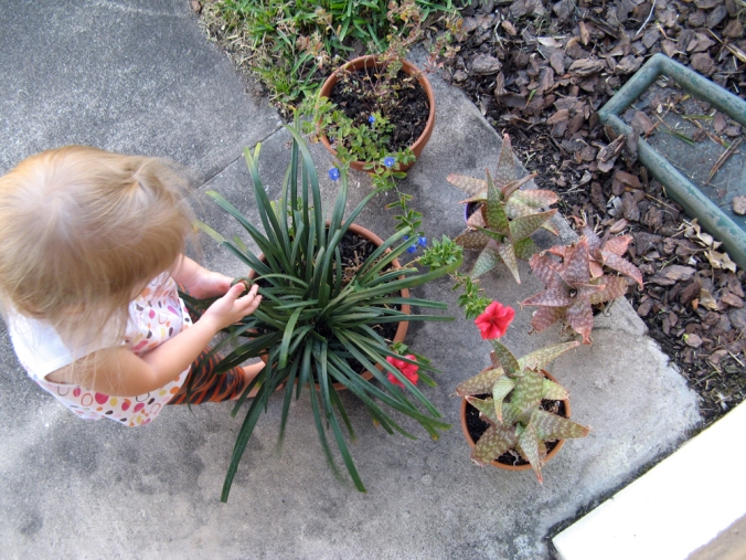 Toddler and Flowers Outside Front Door via Oaxacaborn