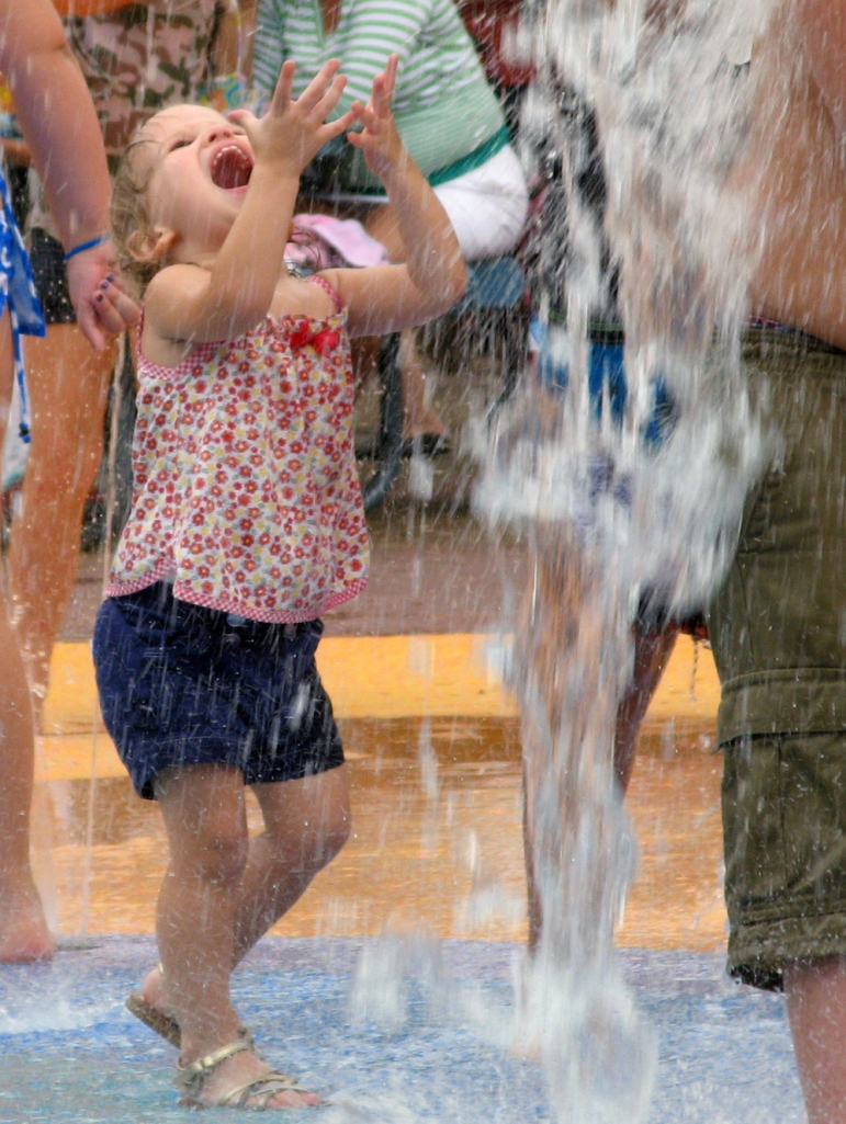 Toddler getting doused with water via Oaxacaborn