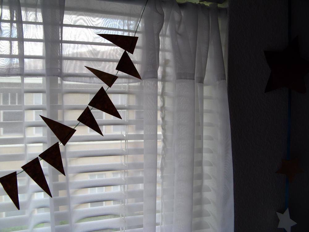 1000px - Silhouette of geometric garland in window via Oaxacaborn