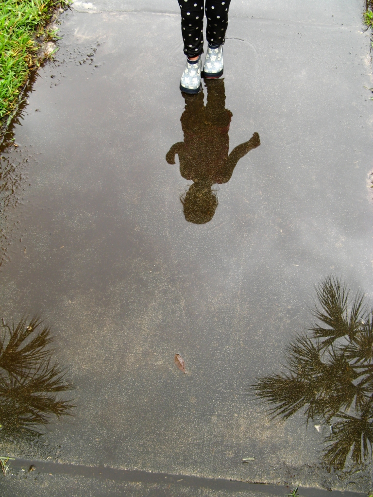 Portrait toddler and palm tree puddle reflection - via Oaxacaborn