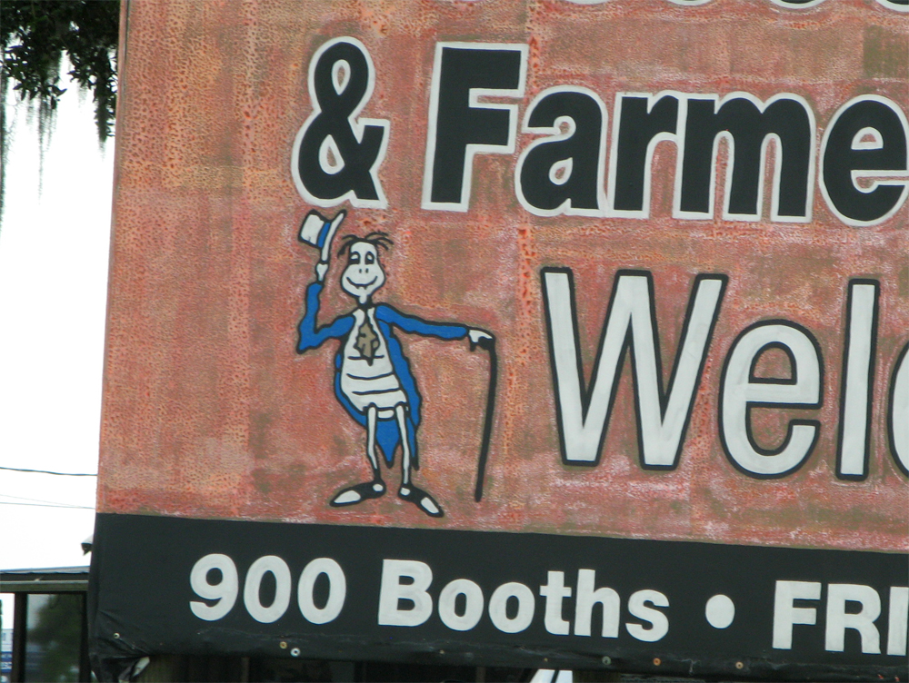 Creepy turtle on Flea and Farmers Market sign