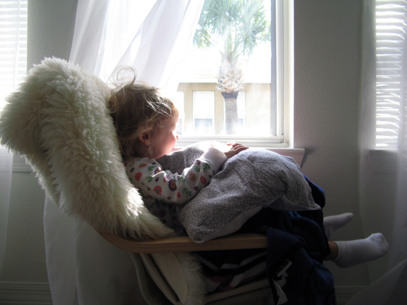 June 2013 - Aveline waking up near window