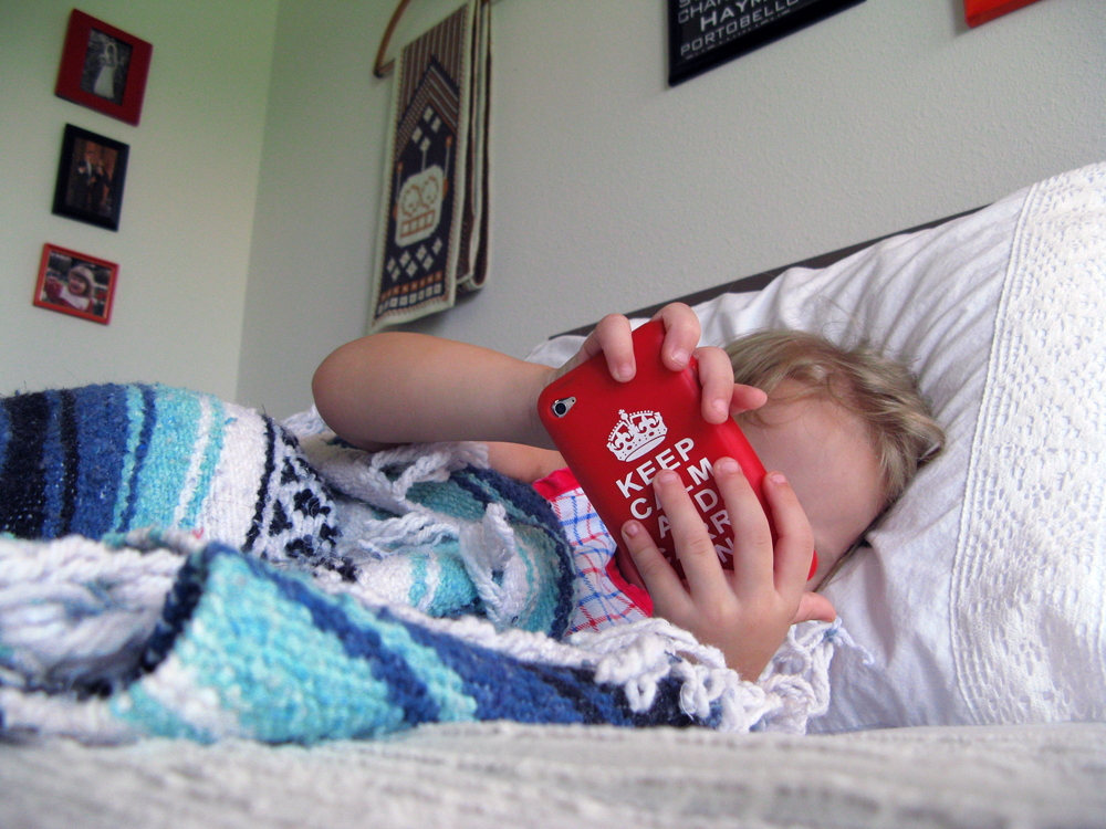 August 2013 - Aveline plays iPod games in bed