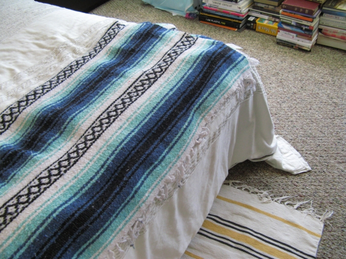 Mexican Blanket and Books on Floor