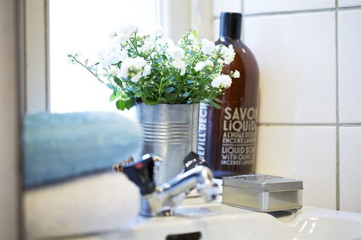 Sink side flowers via Real Estate Listing by Alexander White as seen on Interiors Stockholm