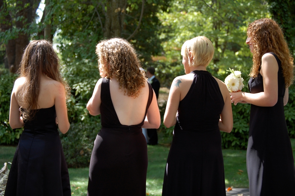 Bridesmaids wearing mismatched black