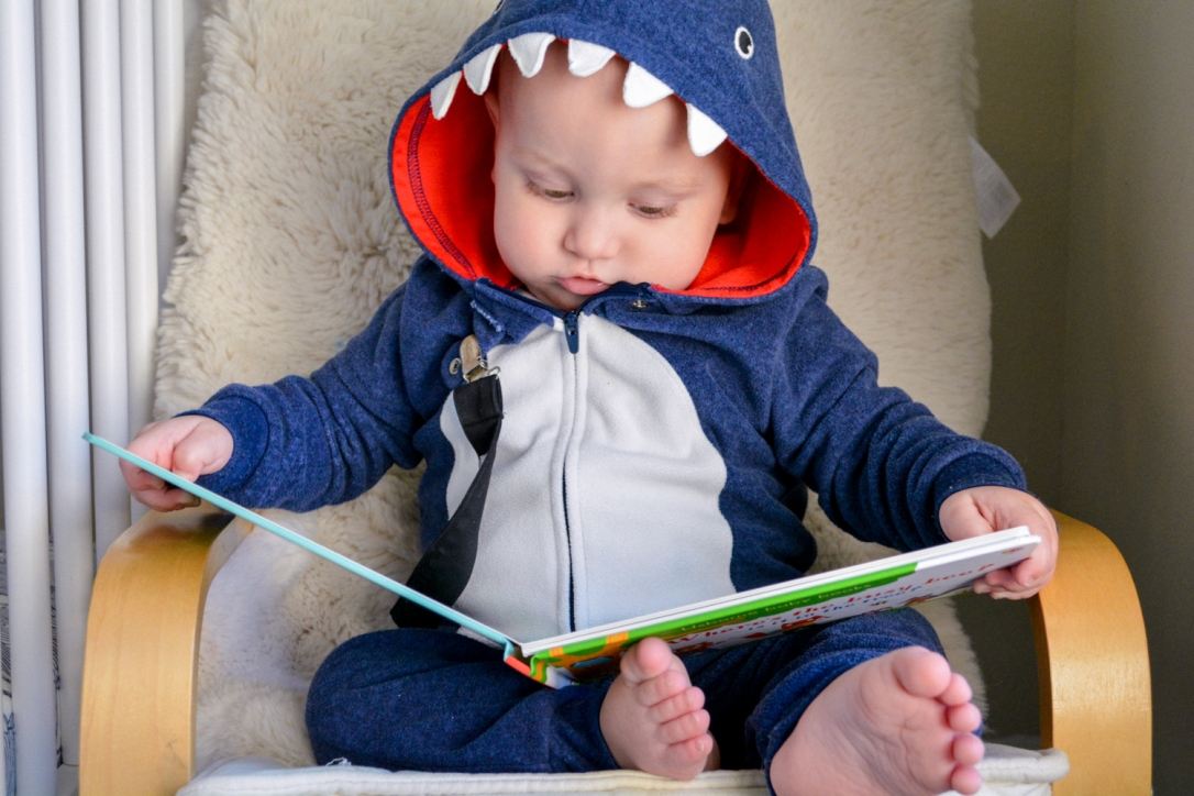 Reading aloud to babies encourages conversation and interaction.